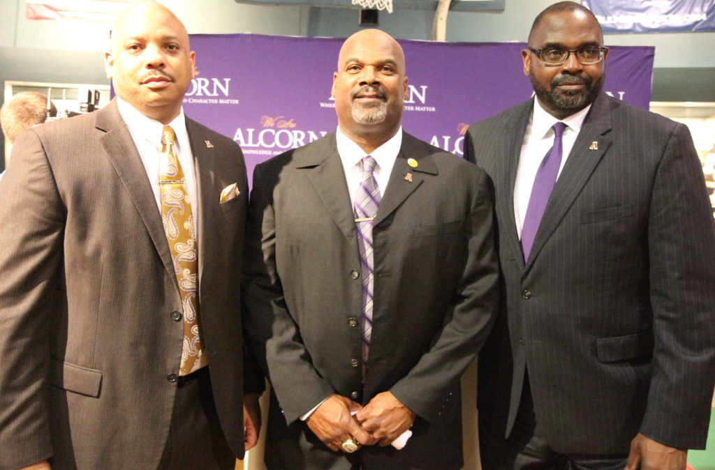 Fred McNair, center, is flanked by Alcorn president Alfred Rankins, Jr., left) and athletic director Derek Horne.