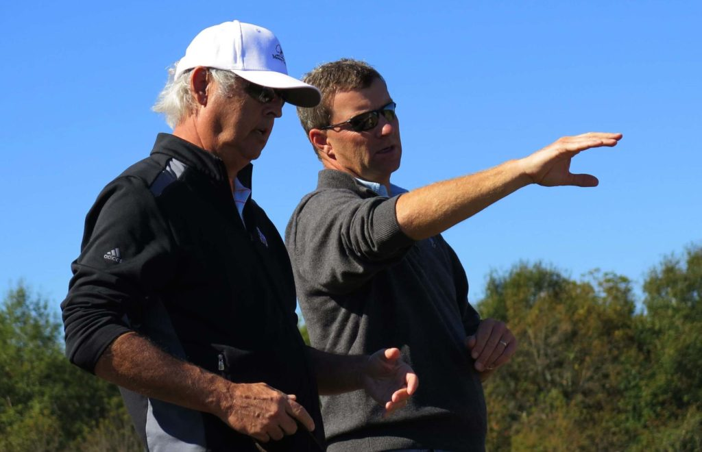 Gil Hanse (right) makes a point to George Bryan during the construction of Mossy Oak golf course.