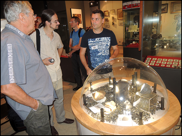 Andre and Martin talking with Vincent next to his dome display.
