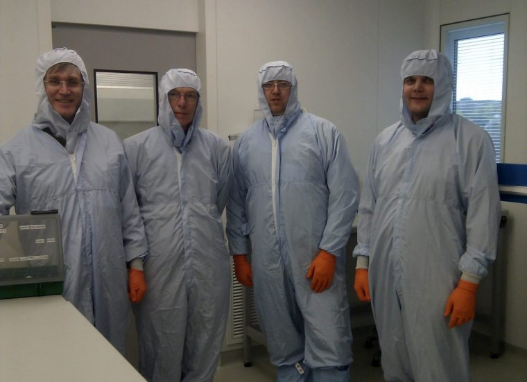 BIMS members Graham Ensor, Kieron Heard, Martin Goff and Matt Smith in the clean room lab facility at the Open University Planetary and Space Science Centre.