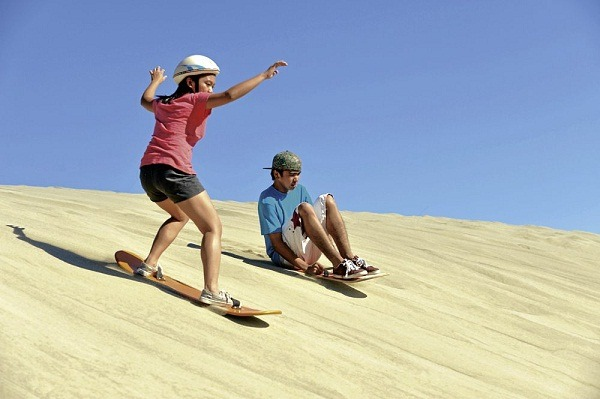 SANDBOARDING: Have a thrilling adventure as you hop onto a 4x4 ride and sandboard down a steep sand slide.
