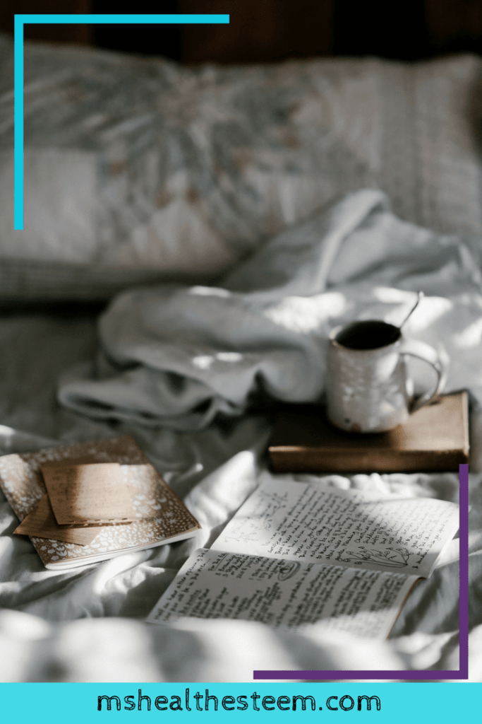 A cozy bed with a book layed out and a cup of tea. Self-care plays an important role in stress relief.