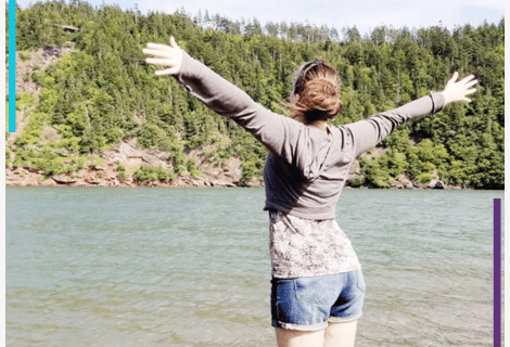 Sara at mshealthesteem.com looking into nature, arms in the air happily, years after her Graves Disease diagnosis.
