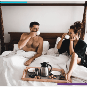 A Couple Enjoys Some Breakfast In Bed