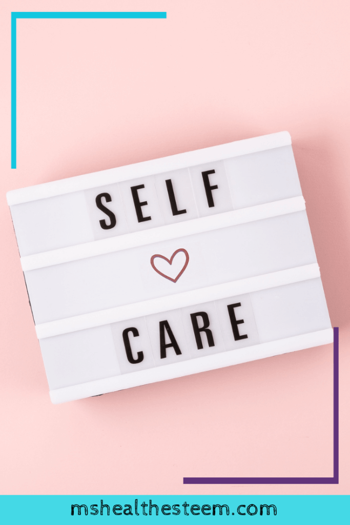 Self-care word on lightbox on pink background flat lay.