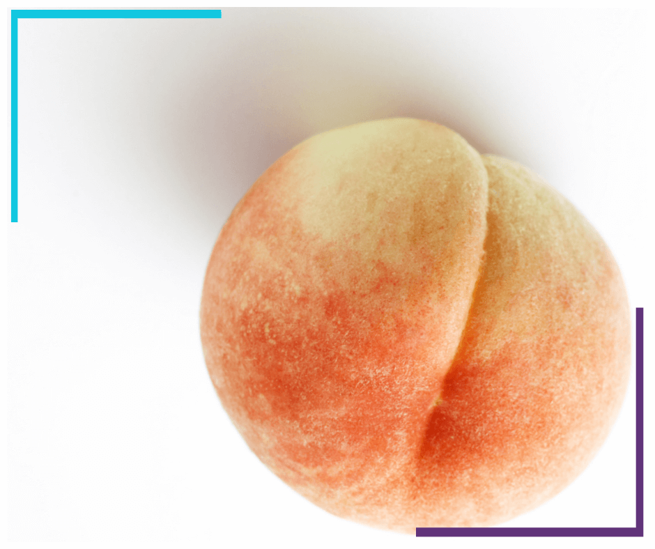 A peach, crack facing up so it looks similar to a butt.