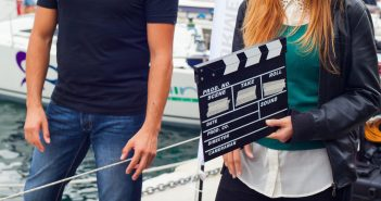 Girl holding clapperboard