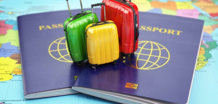 Passport and suitcases on the world map.