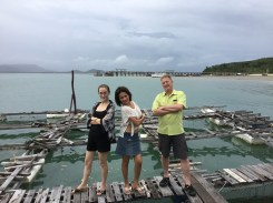 Me, P'Nong, and Dad at the floating restaurant after lunch.