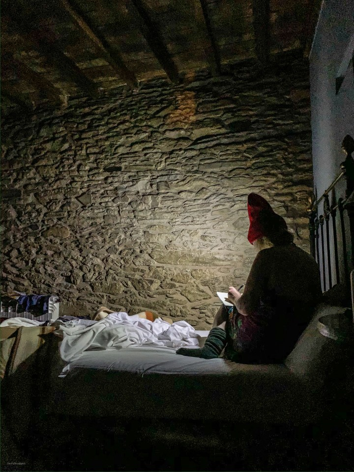 my sister stretching and writing her diary in the early dawn, camino de Santiago pic: Kerstin rodgers/msmarmitelover.com
