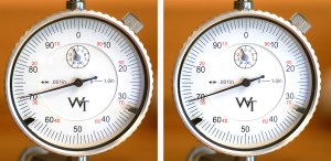 """This pair of photos shows the amount of warp on a fired case measured using a V-block-style concentricity fixture with a dial indicator. As before, the """"70"""" on the dial indicator is just the position of the indicator. What matters is the area the indicator sweeps, which shows they are a little less perfect than the new ones above."""