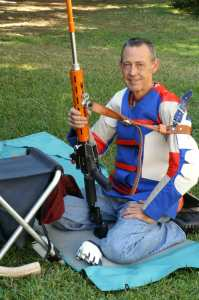 Glen Zediker with competition rifle, sling and competition gear
