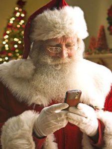 Santa looking at an old smart phone