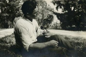 Erdman holding an owl, circa 1918 (A006438)