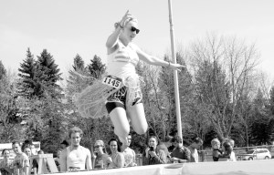 A runner finishes the 5K Splash Dash by jumping in the Polar Plunge. By BREANN LENZMEIER• lenzmeiebr@mnstate.edu