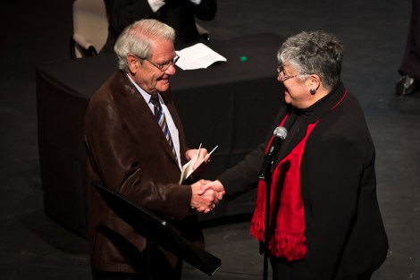 William C. Marcil and President Edna Szymanski shake hands after the announcement of a $1 million gift to create the William C. Marcil and Jane B. Marcil Center for Innovative Journalism. PHOTO BY BEN GUMERINGER