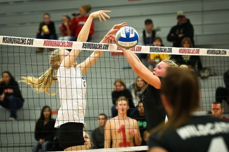 Kaitlin VanWinkle puts up a point in the Dragons matchup against No. 10 Wayne State on Friday in Northern Sun Intercollegiate Conference action. VanWinkle had seven kills and two blocks in the Dragons three set loss to the Wildcats.