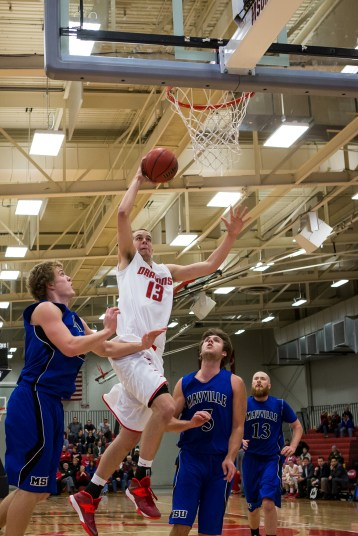 Freshman forward Matt Nelson goes for the dunk in the Dragons home opener. The Dragons defeated the Comets on Saturday 84-51.