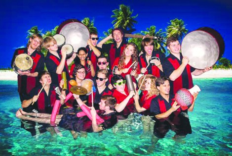 """Members of MSUM's percussion ensemble """"Fuego Tropical"""" pose with their instruments."""