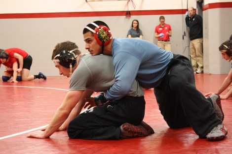 Seniors Connor MacGregor (left) and Angel Vega (right) practice drills. The Dragons continue their season on Saturday at the Bison Open in Fargo.