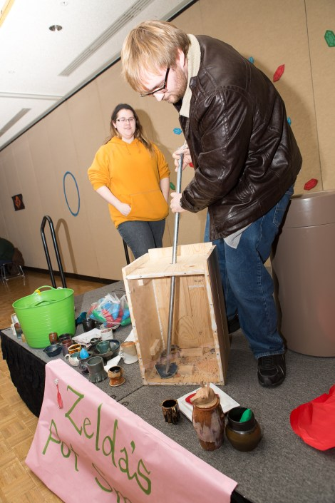 "Physics sophomore John Ragan partakes in one of the most popular events at the carnival, a ""Legand of Zelda"" themed pot smash."