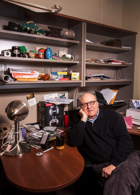 Mark Strand poses in his office surrounded by momentos from the past 25 years spent teaching at MSUM.