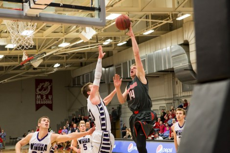 Freshman guard Aaron Lien puts a shot up in the first half of the men's game on Saturday. With two seconds remaining in the game, Lien hit the game winner as the Dragons prevailed to beat NSIC leading Winona State on Saturday.