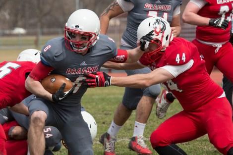 Junior wide receiver Adam Jiskra looks to evade a defender during the game on Saturday.  Photos by Ben Gumeringer