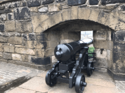 Cannon propped through a castle window.