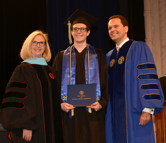 Right: Dr. Carol Christian, academy director, and MSU President Jay Morgan congratulate graduate Alex Vermillion of Hazard.