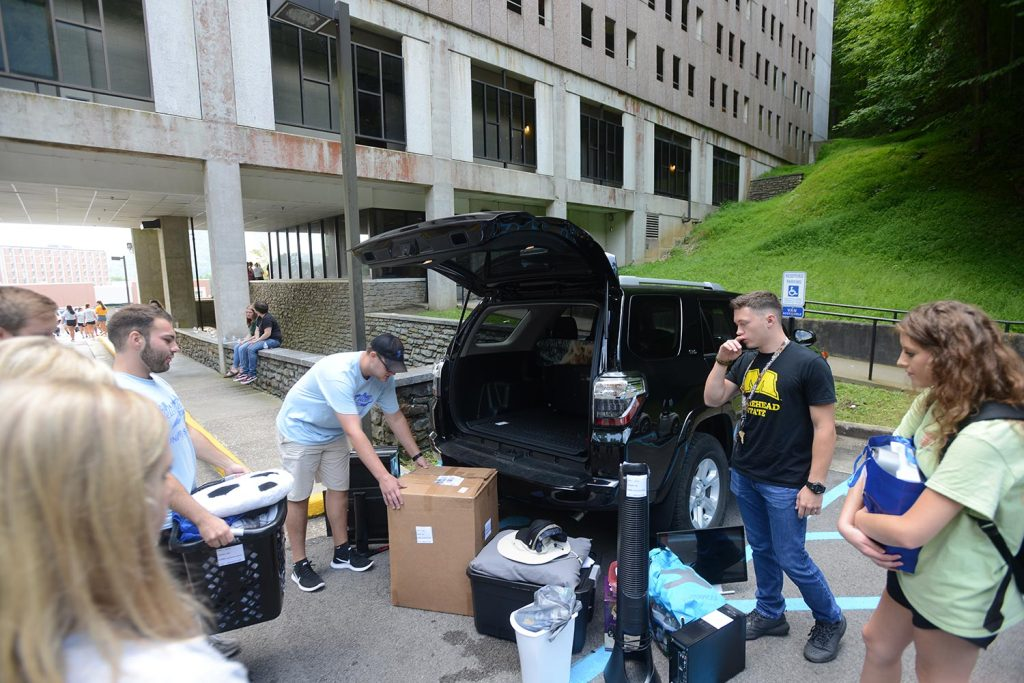 Donovan Ward unloading vehicle at move-in day.