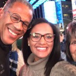 Elle Howard (center) with her parents Eric Howard (81) and Linda Thacker (83, 92) on an MSU alumni trip to New York City in 2018.