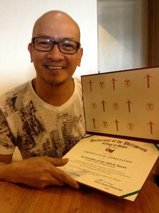Al Peter Salanga with award for his contribution