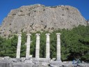 Columns of the temple of Athena in the shadow of the mountain