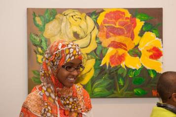 "Opening of the ""Flowers, Flores, Ubaxa"" exhibition at the Mount Baker Neighborhood Center for the Arts. Featured Artist Hawo Ali's extended family came to see the exhibition."