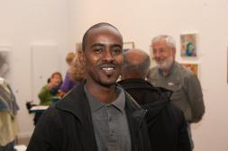 "Opening of the ""Flowers, Flores, Ubaxa"" exhibition at the Mount Baker Neighborhood Center for the Arts. Artist Waiss Ali."