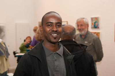 """Opening of the """"Flowers, Flores, Ubaxa"""" exhibition at the Mount Baker Neighborhood Center for the Arts. Artist Waiss Ali."""
