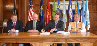 Governor Steve Bullock signs SB 262 into law at the Capitol on April 24, 2015. The CSKT Compact must now go to Congress for approval. Image: Governor Steven Bullock