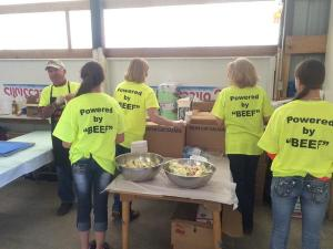 Wheatland Co. Stockgrowers cooking beef at the Range Days Dinner. Image via @lanecoynordland Twitter