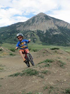 kid mountain biking near Crested Butte Mountain