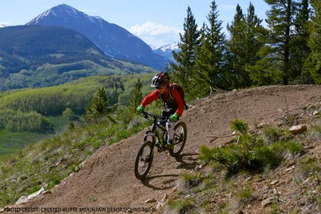 youth mountain biker on flow trail at Evolution Bike Park