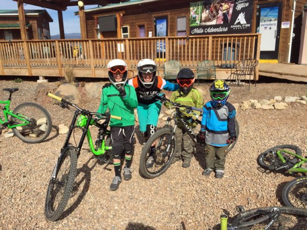 Family geared up for riding downhill at Evolution Bike Park