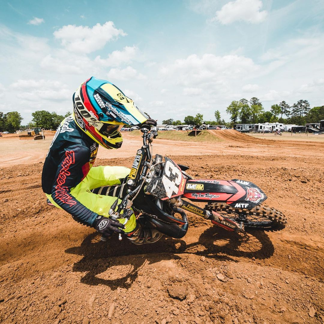 Tiger Wood rounds a corner on the supercross track