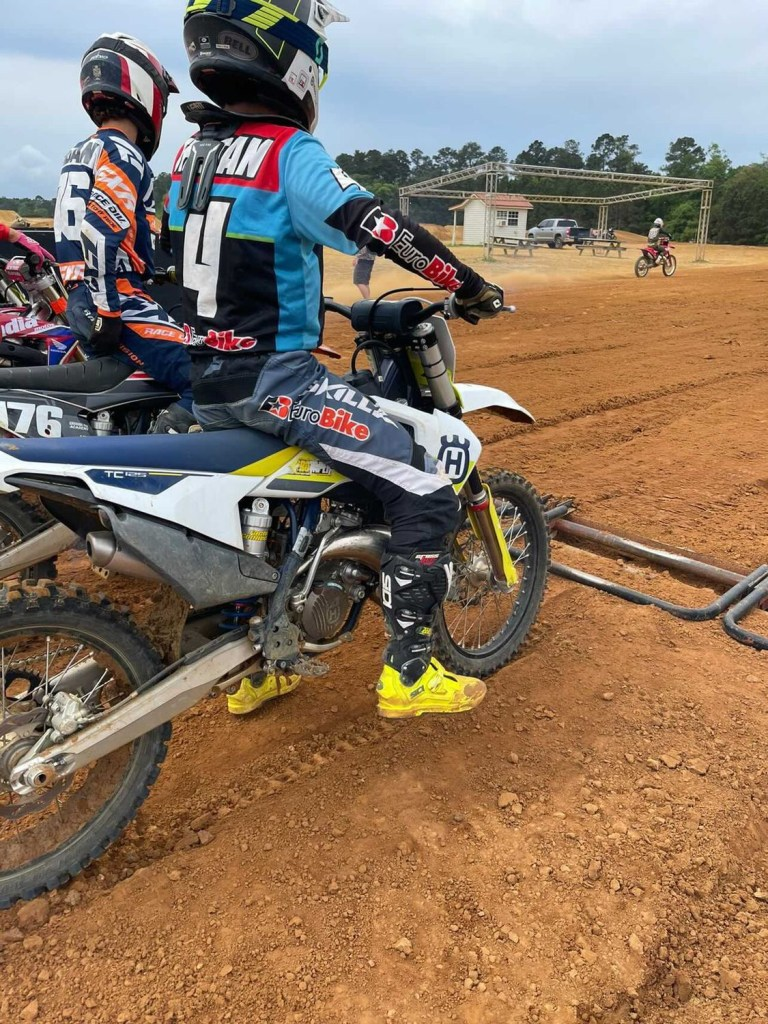 Tristan Rubio lines up at the start gate at MTF's supercross track during the motocross training program.