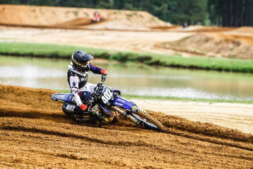 Gage Linville flies through a corner on the motocross track at MTF.