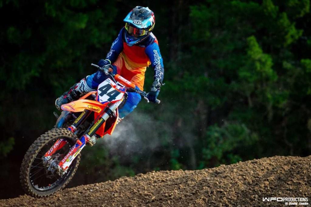 Noah Smerdon jumps through a rhythm section on the motocross track.