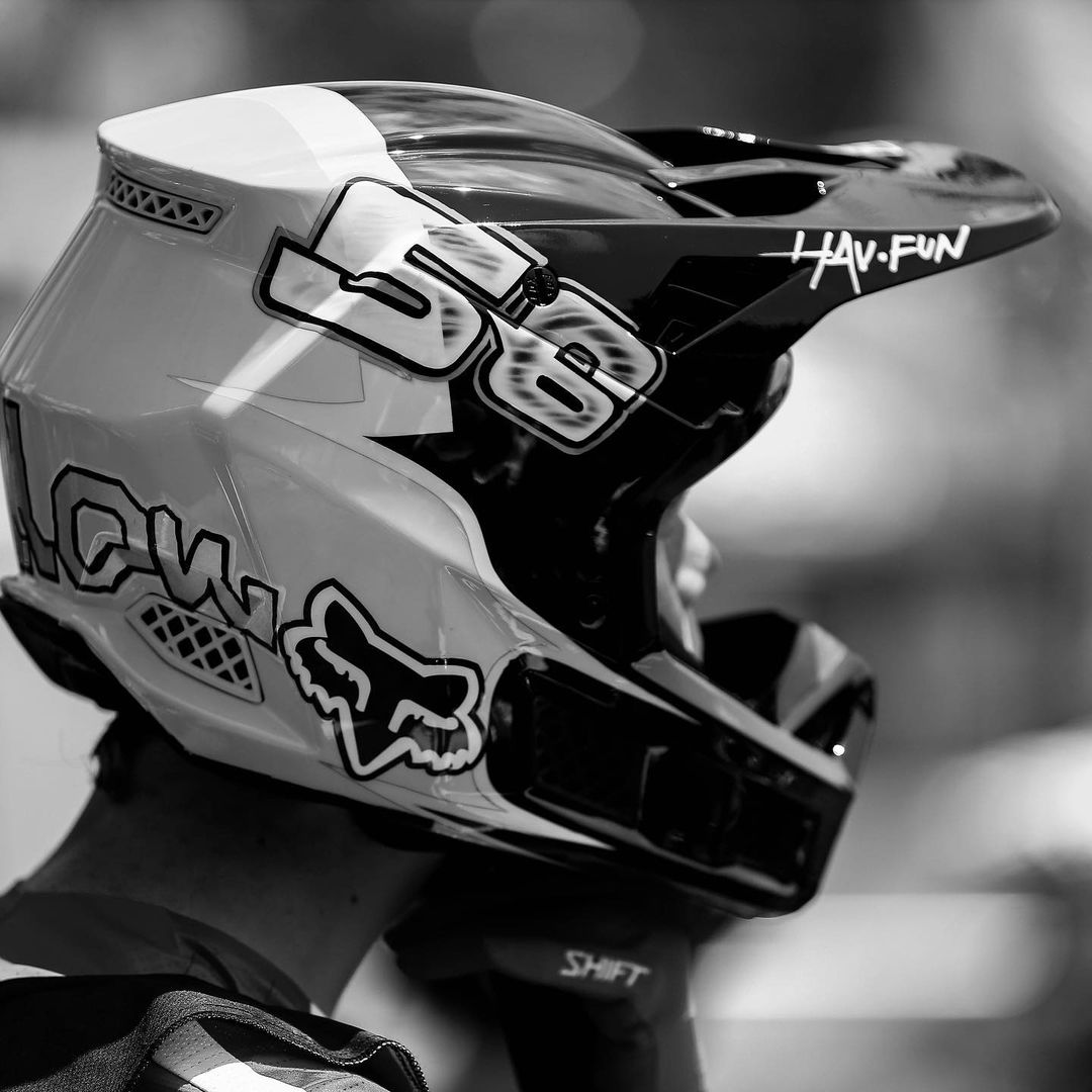 Black and white photo showing the side of a motocross helmet with the number 56.