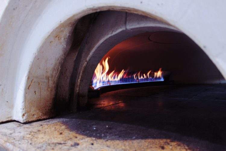Showing a View of the Inside of the Pizza Oven at MTH Pizza