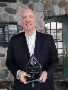 Larry Mansch holding his Lawyer of the Year award