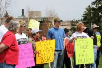 Photo of people holding signs in support of Barry Beach's release